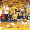 Fans look on as kids try to land their paper airplanes closest to center court at halftime of the class A regional boys basketball championship at Teutopolis High School in this 2003 photo.<br /> Eric Williams photo
