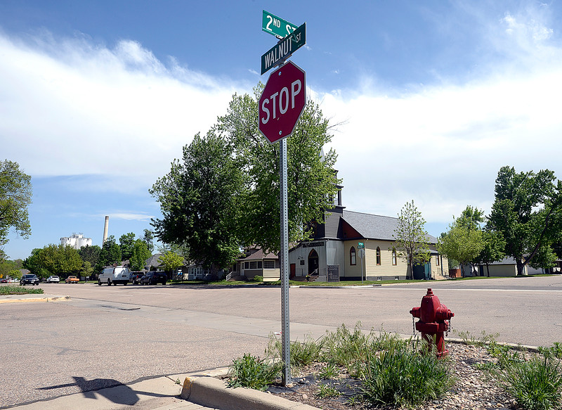 The stop sign and street signs at Second Street and Walnut Street in Windsor are upright Thursday, May 17, 2018, ten years after the tornado with what is now Calvary Chapel in the background. (Photo by Jenny Sparks/Loveland Reporter-Herald)