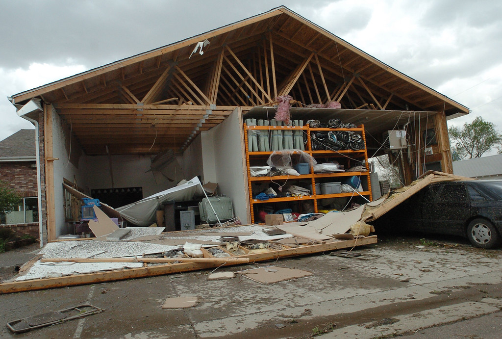 . The west wall of Arapahoe Rental, 201 Main St., Windsor, lies in the parking lot and exposes the interior of the building after the tornado in 2008.  (FilePhoto by Steve Stoner/Loveland Reporter-Herald)
