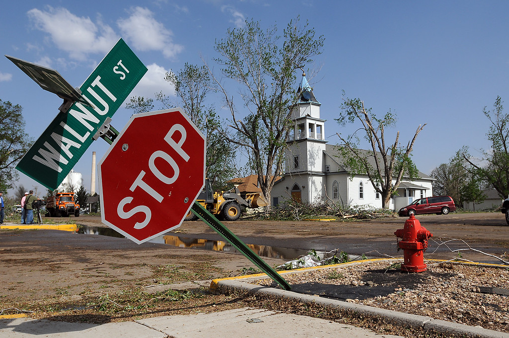 . Crews clean up the intersection of Second and Walnut Streets near the Ascension Anglican Church after the tornado in 2008  in Windsor.  (File Photo by Christopher Stark/Loveland Reporter-Herald)
