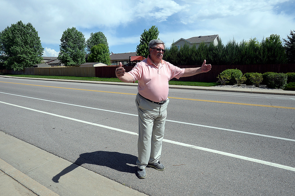 . Standing on Garden Drive near Cornerstone Drive in the same area where a cyclist was photographed among the destruction from the tornado ten years ago in Windsor, Terry Walker, Director of Public Works for the city of Windsor, talks Thursday, May 17, 2018, about the path of the tornado and how this neighborhood sustained much of the damage. (Photo by Jenny Sparks/Loveland Reporter-Herald)