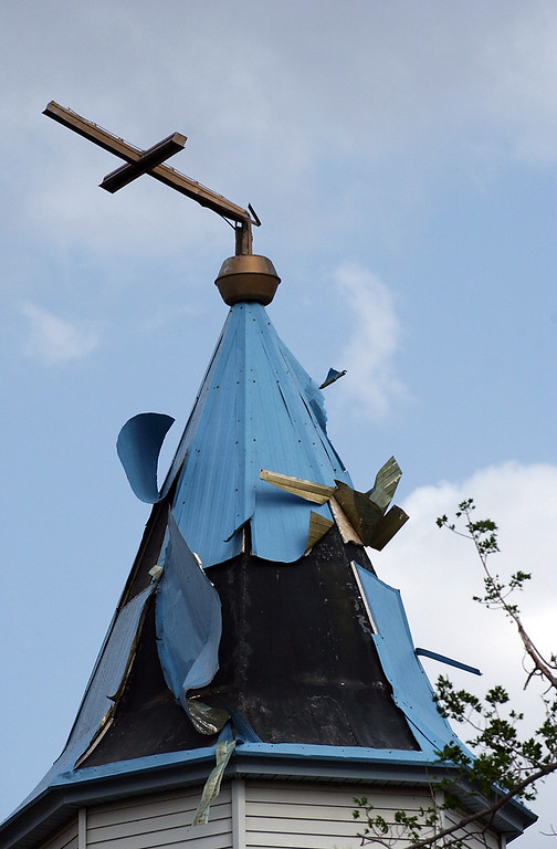 . A cross teeters atop the the Ascension Anglican Church in Windsor after the tornado in 2008.  (File Photo by Christopher Stark/Loveland Reporter-Herald)