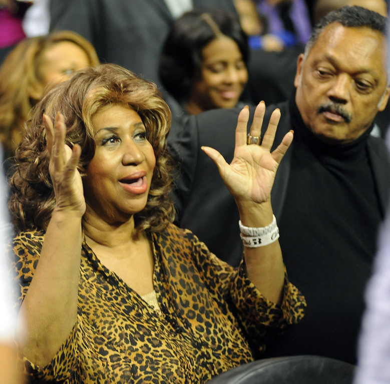 . Aretha Frankin and Jesse Jackson enjoy the game between the Detroit Pistons and the Miami Heat.  Photo taken on Friday, February 11, 2011, at The Palace in Auburn Hills, Mich.  (The Oakland Press/Jose Juarez)