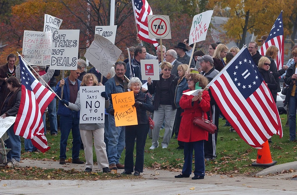 . Tea Party members protest outside of the Rochester Schools Administration Building before Gov. Jennifer Granholm arrived to meet with Senate Majority Leader Michael Bishop and Representative Tom McMillin.