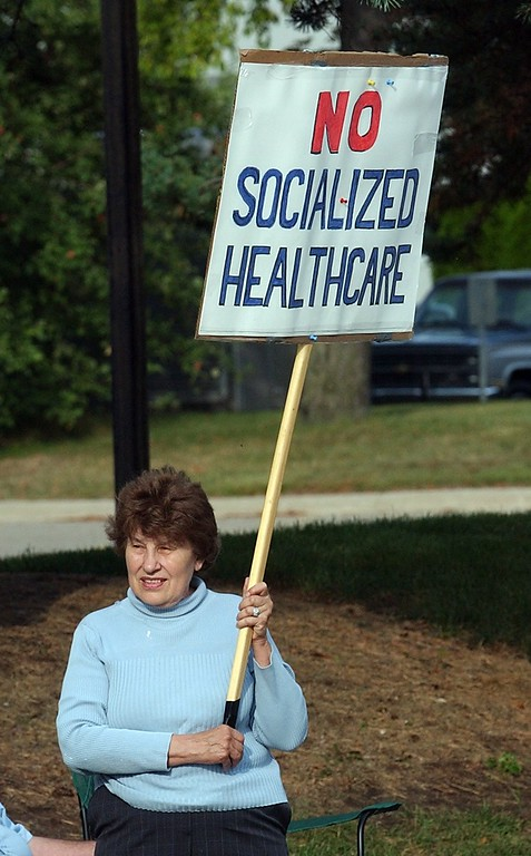 """. Carlene Fanning, of Bloomfield Twp., with her sign during the Healthcare Freedom \""""Tea Party\"""" protest along Kirts Blvd. in Troy. About 100 people lined the road near the district office of Democratic U.S. Congressman Gary Peters"""