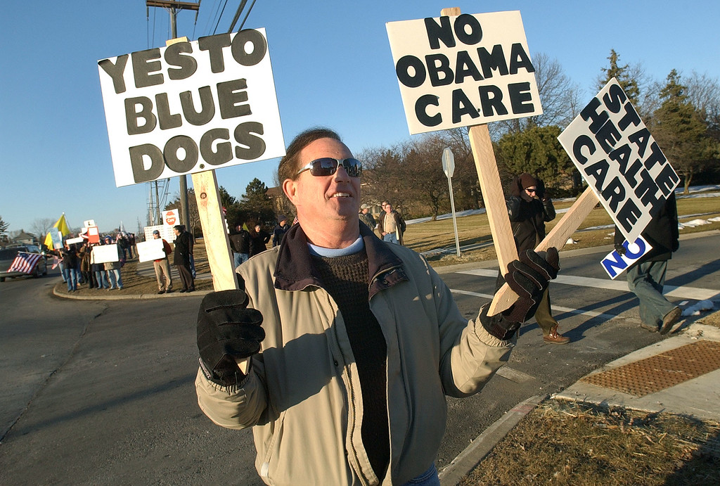 . Tea Party activist Howard Elandt protests along Rochester Road, near a location where Congressman Gary Peters was scheduled to speak.  Photo taken on Friday, March 5, 2010, in Rochester Hills, Mich.  (The Oakland Press/Jose Juarez)