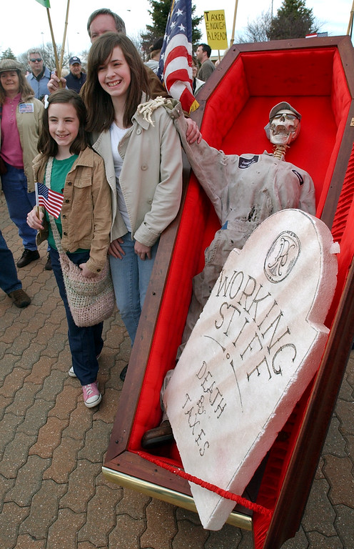 """. Majesty Pellestier (left, age 10) and Blessing Pelletier (age 13) stand with a mock skeleton, which has a sign that reads \""""Working Stiff, Death By Taxes,\"""" during the Tax Day Tea Party.  Photo taken on Wednesday, April 14, 2009, in Troy, Mich.  (The Oakland Press/Jose Juarez)"""