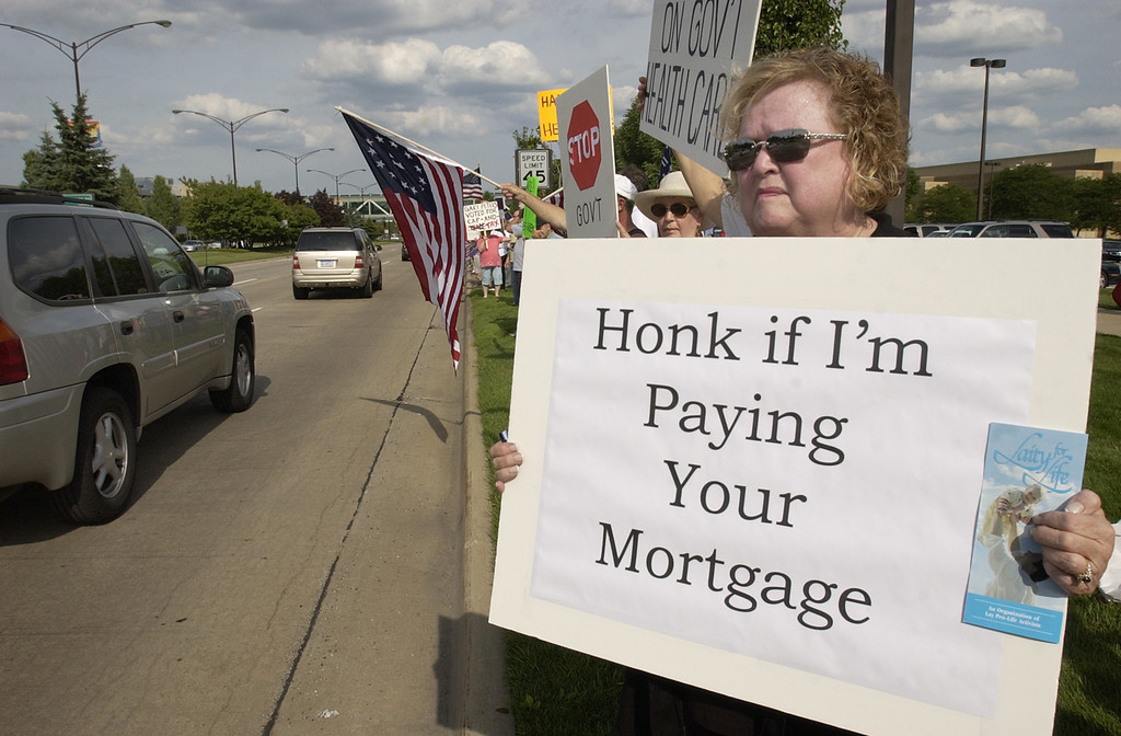 . Nancy Nevers, who says she is a trustee in Macomb Township, Mich., shows her displeasure with the Obama administration as she and several hundred other protestors gathered for a Tea Party, at the corner of Big Beaver and Coolidge Roads in Troy, Mich., Thursday, July 30, 2009.  (The Oakland Press/Jose Juarez)