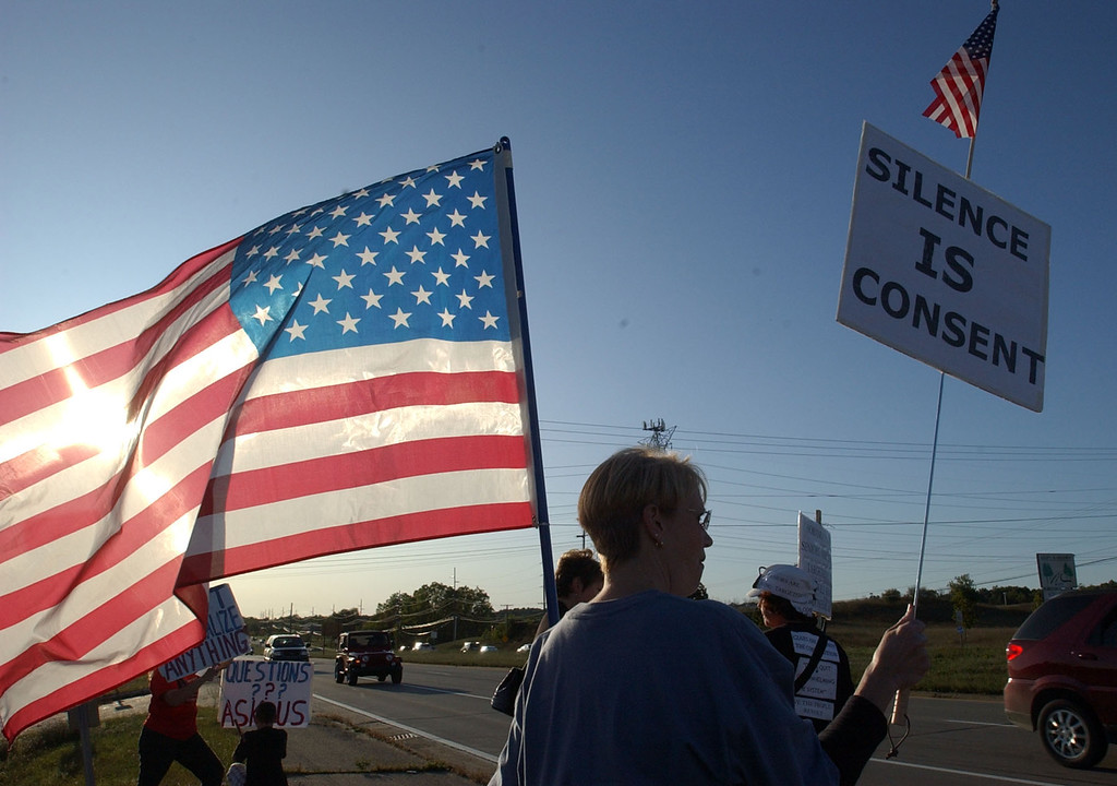 . Debbie Allen, of Waterford Twp. was one of the Let Freedom Reign protesters staging a tea party at the corner of M-59 and Bogie Lake Road in White Lake Twp.