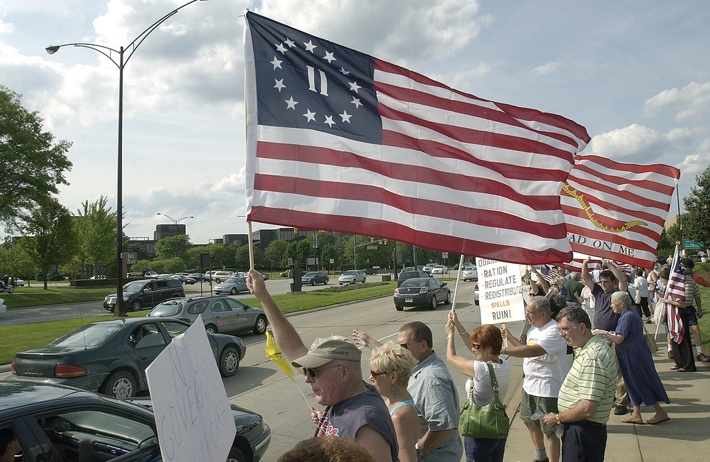 . Several hundred protestors gathered for a Tea Party, at the corner of Big Beaver and Coolidge Roads in Troy, Mich., Thursday, July 30, 2009.  (The Oakland Press/Jose Juarez)