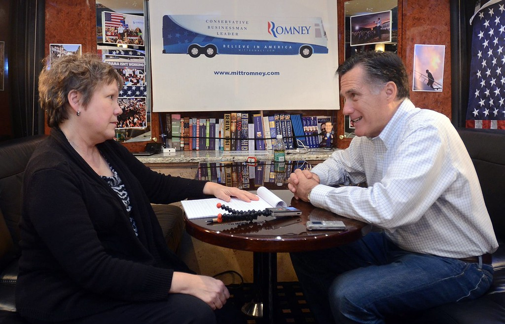 . Oakland Press reporter Carol Hopkins with Republican presidential candidate Mitt Romney during a one-on-one interview with the former Michigan native in his campaign bus after he spoke to Tea Party supporters during a stop at Bakers of Milford, Thursday February 23, 2012. (Oakland Press Photo By: Vaughn Gurganian)