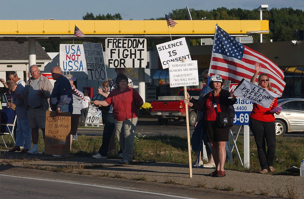 . Some of the Let Freedom Reign protesters stage a tea party at the corner of M-59 and Bogie Lake Road in White Lake Twp.