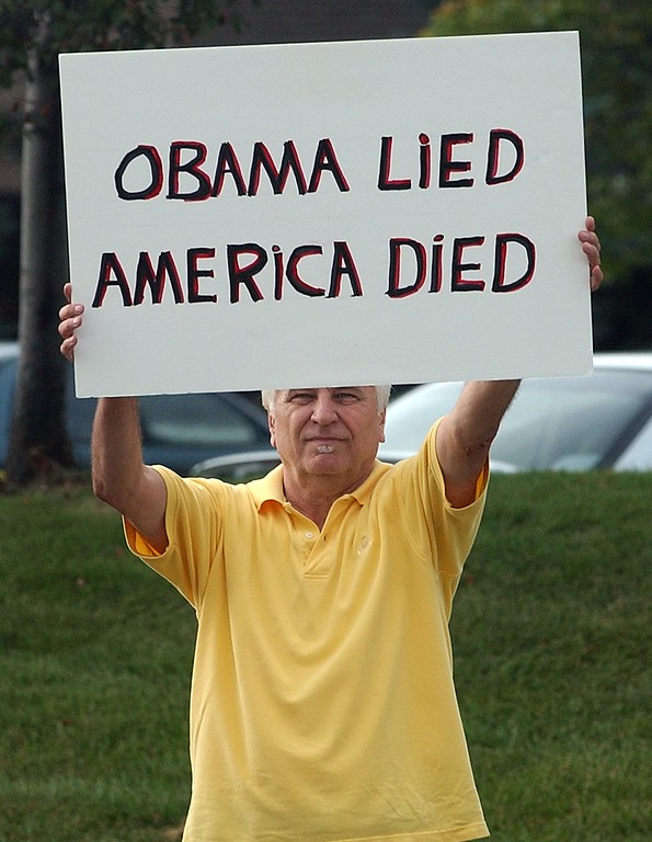 """. Steve Kiertanis, of Chesterfield Twp., holds up his sign during the Healthcare Freedom \""""Tea Party\"""" protest along Kirts Blvd. in Troy. About 100 people lined the road near the district office of Democratic U.S. Congressman Gary Peters"""
