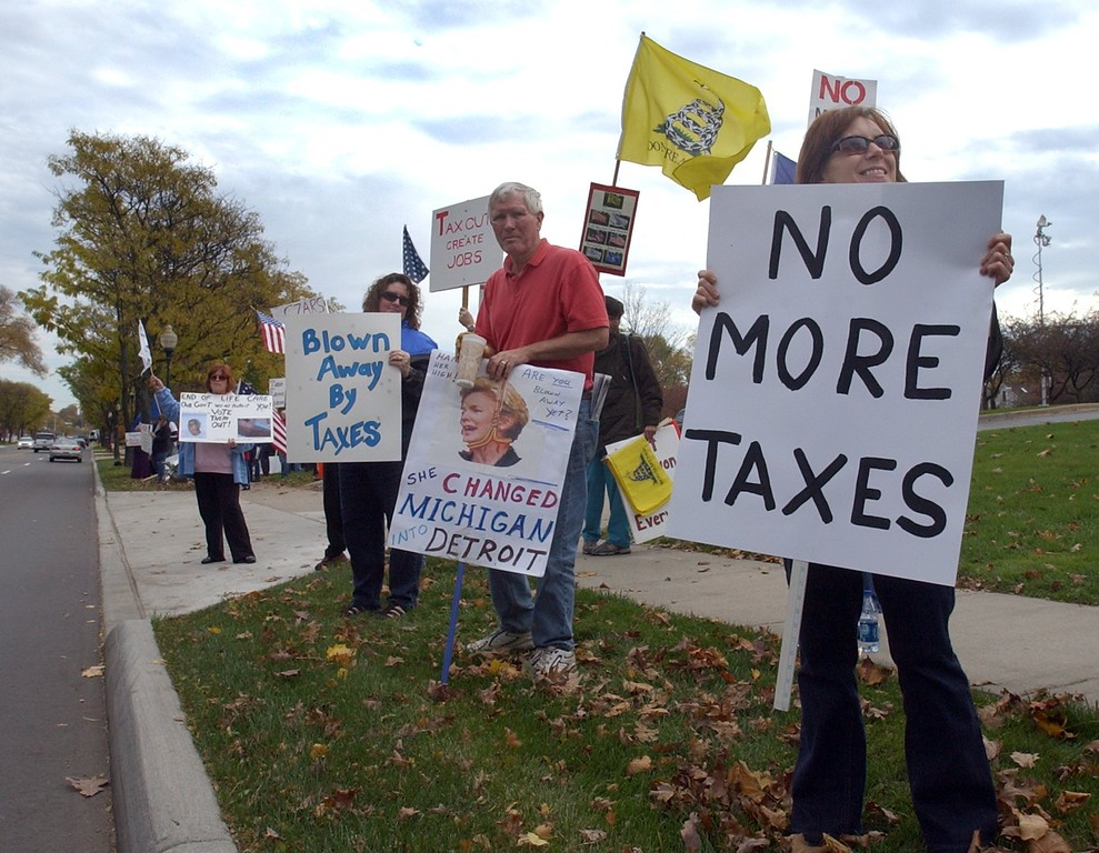 . (right) Karen Stone, of Shelby Twp., along with other Tea Party members, protest outside of the Rochester Schools Administration Building before Gov. Jennifer Granholm arrived to meet with Senate Majority Leader Michael Bishop and Representative Tom McMillin.