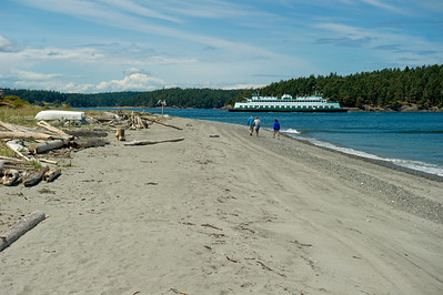 Beach combing along Flat Point.  The westbound WSF Evergreen State