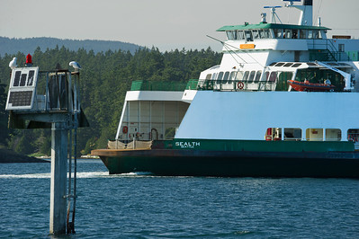 "The Washington State Ferry ""Sealth"" passing by the navaid at Flat Point"
