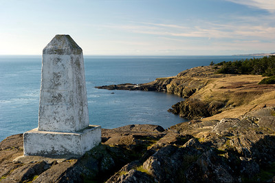 "Monument at Iceberg Point.  A plaque on the reverse side denotes ""....turn 7"" of the water border between Canada and the United States."
