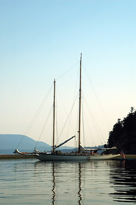 A staysail schooner lays at anchoroff Spencer Spit