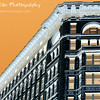 "Veering To The Left by Lora Mosier<br /> <br /> This building is in Cleveland, Ohio and although it was a pleasant picture to look at ""as is"", I wanted to make it different than the photos that everyone else has of it.  So, I made it into a negative....oh look, something different.  <br /> <br /> And it certainly worked.  This photo was one in my collection at the Sur Saint Clair Gallery in Toledo, Ohio and people were actually making a bee-line over to look at it. <br /> <br /> Thanks to everyone who came out to the gallery during Toledo's Artwalk.  It was great to meet so many people and have such interesting conversations."