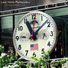 In A New York Minute by Lora Mosier<br /> <br /> It seemed as if time stood still as I was taking this picture. You can stop laughing now.<br /> <br /> On my whirlwind tour of NY, I took the time (pun intended) to take this shot.