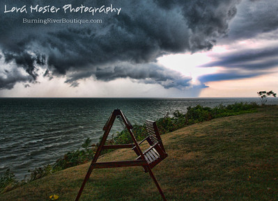 Polterstorm by Lora Mosier  Had just enough time to get this shot before the deluge of rain sent me running back to the house...had to get my camera to dry land.