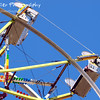 Life's a Carnival by Lora Mosier<br /> <br /> Just seeing a ferris wheel brings to mind the scents of the midway ~ cotton candy, caramel corn, corn dogs....you know, all those healthy snacks.  <br /> <br /> This was taken at Cahoon Memorial Park in Bay Village, Ohio.