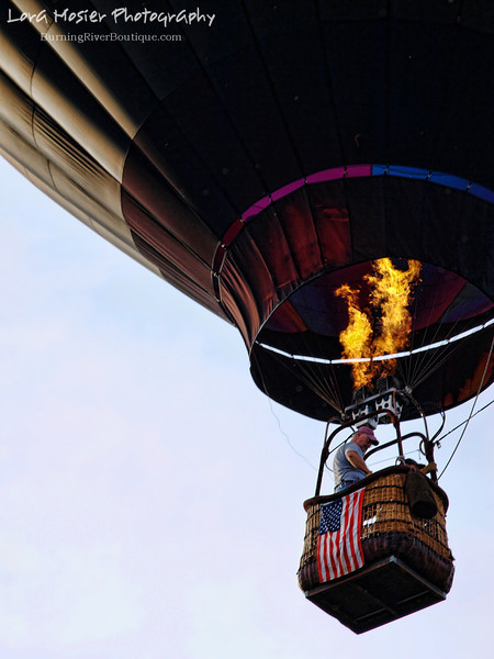 Twin Fires by Lora Mosier<br /> <br /> Now that's a way to fly the flag.