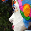 "To the Max by Lora Mosier<br /> <br /> This was taken at ""Parade the Circle"" in University Circle, Cleveland, Ohio.  Every summer there is a grand and colorful parade honoring all art forms.  <br /> <br /> As the title suggests, this giant paper mache puppet was honoring Peter Max."