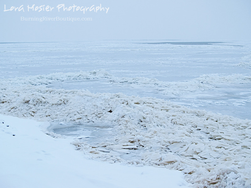 Smooth Sailing or Not by Lora Mosier<br /> <br /> On Groundhog Day I took some scraps out to the bluff for the varmints and these shards-o-ice made up the shoreline of my little corner of Lake Erie.