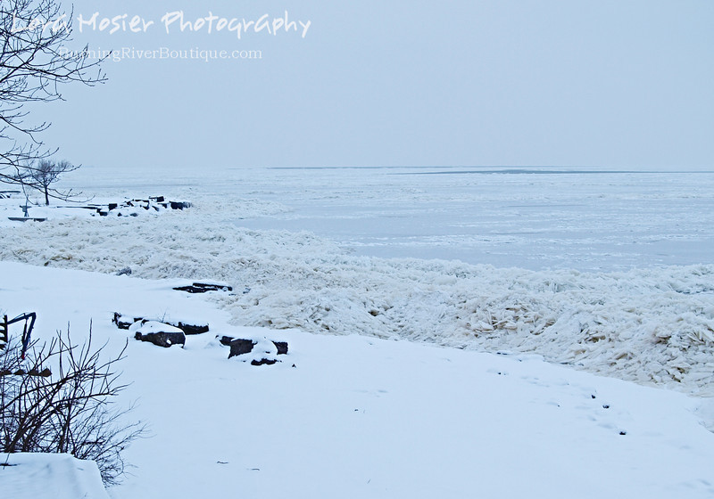 West Tundra by Lora Mosier<br /> <br /> On Groundhog Day I took some scraps out to the bluff for the varmints and these shards-o-ice made up the shoreline of Lake Erie.