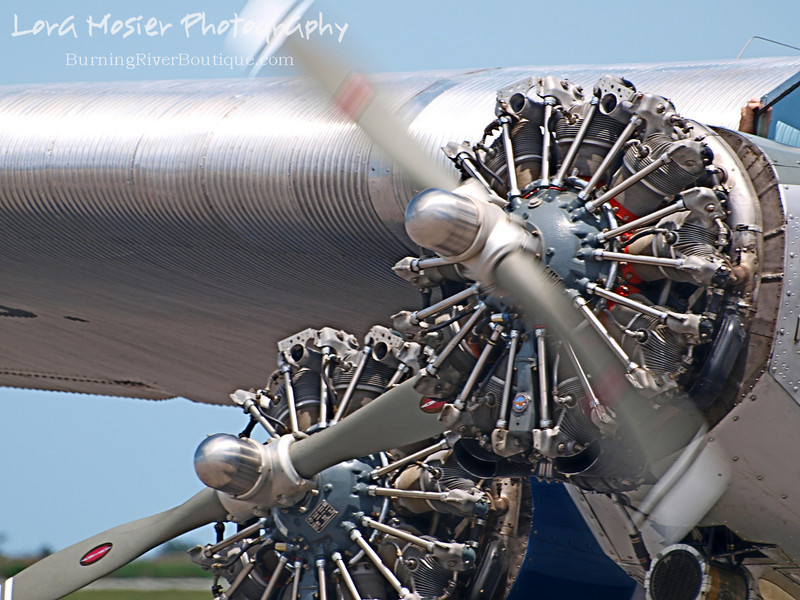 Ford Tri Motor by Lora Mosier<br /> <br /> Yes, I know that tri is three and that there are only two motors in this picture. <br /> <br /> This plane was built in 1929 by the Stout Metal Airplane Company which was a division of the Ford Motor Company. <br /> <br /> Burke Lakefront Airport in Clevelland, OH was where it made its appearance the first weekend of June, 2013.