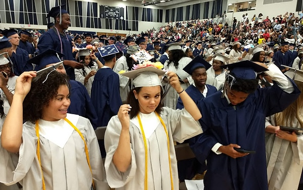 . Richard Payerchin - The Morning Journal <br> Lorain High School received their diplomas during the 2018 Lorain High School commencement held June 5, 2018, and here get ready to switch their tassel to signify their new status as Lorain Titan alumni.