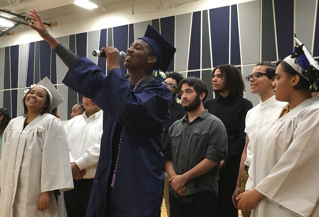 . Richard Payerchin - The Morning Journal <br> The Lorain High Choir, with soloists, seniors Emmanuel Brown, Shyann Castro and Annastasia Williams, sang the senior song: �I�ll Make the Difference,� by Moses Hogan, as part of the Lorain High School commencement on June 5, 2018.