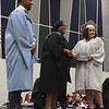 Richard Payerchin - The Morning Journal <br> Lorain City School CEO David Hardy Jr. and Lorain High School Principal Robin Hopkins greeted graduating seniors and gave them their diplomas during the 2018 Lorain High School commencement held June 5, 2018.