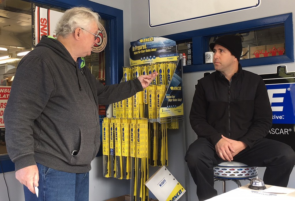 . Richard Payerchin - The Morning Journal <br> At right, Muzik\'s Auto Care owner John Muzik talks to customer Paul Bartulica in the shop office at 704 W. Erie Ave., Lorain, on Nov. 9, 2017. The garage, which also uses the name Muzik Bros., this year is celebrating its 75th anniversary in business.