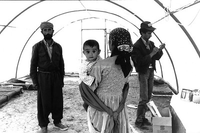 Young Kurdish mother gets medical help in a Refugee camp, Nth Iraq,1991