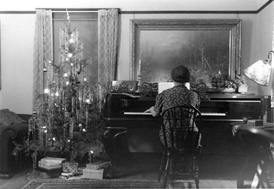 Margaret Smith plays the piano during a 1940's Christmas season in the family's Los Altos home. After her death in 1973, the Gilbert Smith House  and its surrounding apricot orchard became part of the Los Altos Civic Center.