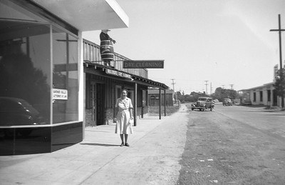 "Wilma Fox Leonard is standing on First Street in front of the ""Gardner Bullis Attorney At Law"" office in the late 1940s. The building was later Clint's Ice Cream, then a restaurant and now is occupied by Los Altos Hardware."