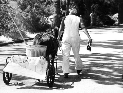 "The sign on the back of the cart reads ""Los Altos Hills Sanitation Dept."" It was the last entry in the May 30, 1981 parade held in Los Altos Hills as part of the town's 25th anniversary celebration of its incorporation."
