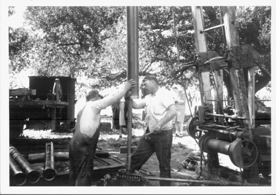 These men are drilling a new water well or deepening an existing one on the Gilbert Smith property in 1940.