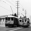"""Los Angeles Railway 1054 on the 35 Line """"Indiana Street Shuttle"""" passes LARy 1212.  1212 is chartered by the Railroad Boosters for their Excursion Number 48 on September 16, 1945.<br /> <br /> Photographer Unknown,<br />  Raymond E Younghans Collection"""
