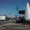 A woman in an SUV ran over a fire hydrant (see it there in the middle of the intersection?) and knocked down a traffic light while we were across the street getting money from the ATM.