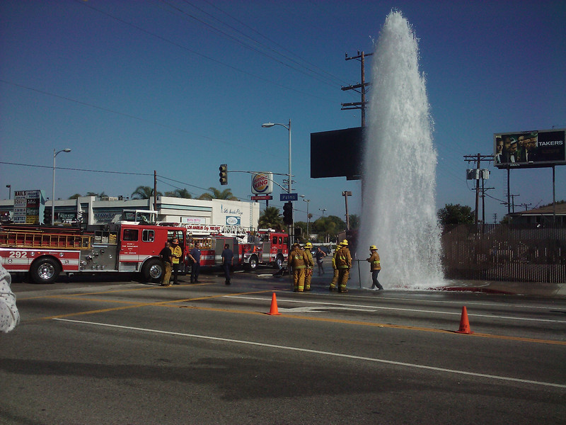 Here are 2 of the 3 fire trucks that showed up and the firemen trying to save LA's water supply.