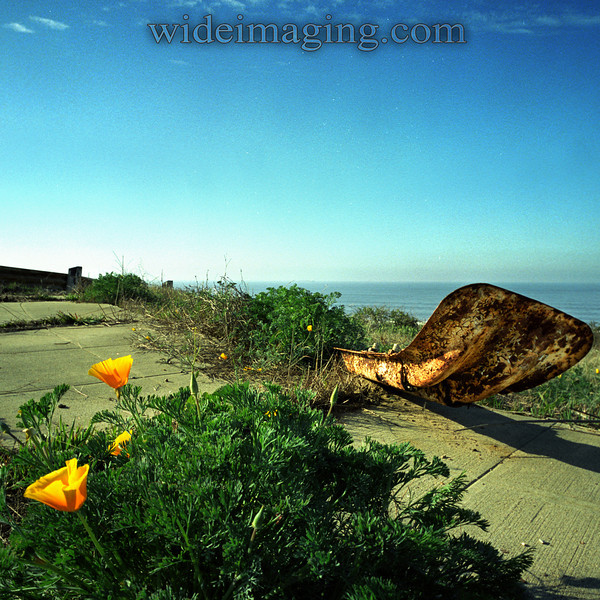 A street guide rail lays on the sidewalk by Ipswitch and Rindge Avenue. Playa Del Rey, Ghost Town, from October 9, 2000.