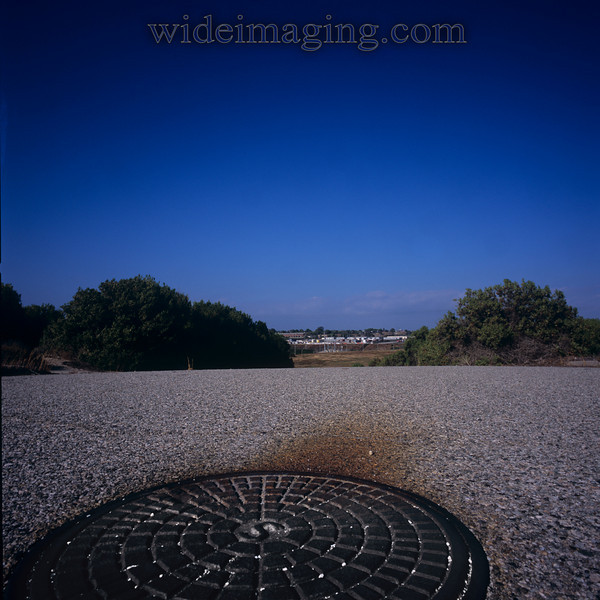 Bolt Street, 'S' manhole cover, with airport storage trailers in the distance: Playa Del Rey, Ghost Town, from October 9, 2000