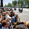 A crowd anxiously awaits to catch a glimpse of the royal couple as they leave Sony PIctures Studios in Culver City, California.