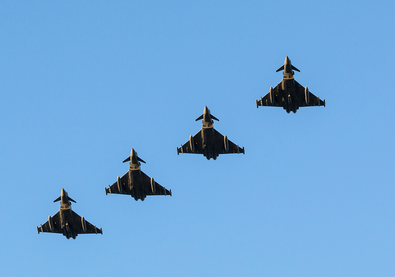 An immaculate formation passes over head for a running break