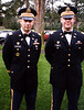 """This picture was taken of me with Captain Frank Escalera, who was soon to be my company commander when I became the Executive Officer for the 176th Signal Battalion. We wore our dress blues with the """"bus driver caps"""" because this was taken during a wedding ceremony."""