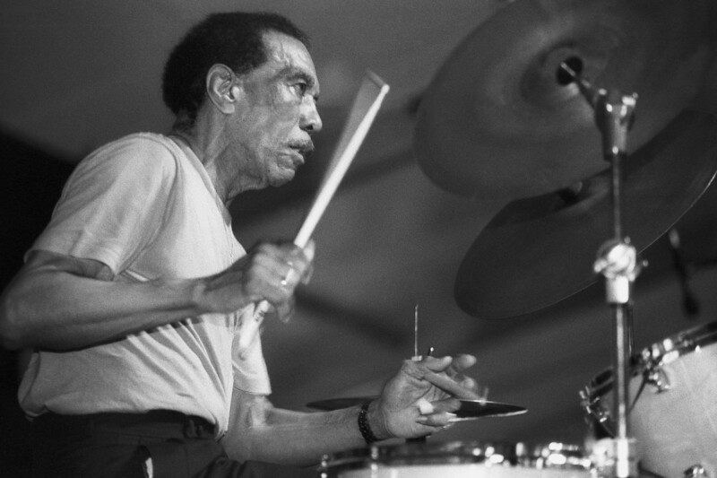 NEW ORLEANS, LA-APRIL 23: Earl Palmer performs at the New Orleans Jazz & Heritage Festival on April 23, 1994. (Photo by Clayton Call/Redferns)