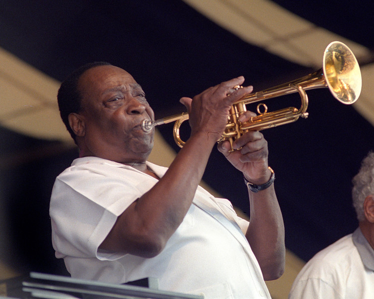 NEW ORLEANS, LA-APRIL 25: Dave Bartholomew performs with Fats Domino at the New Orleans Jazz & Heritage Festival on April 25, 1999. (Photo by Clayton Call/Redferns)